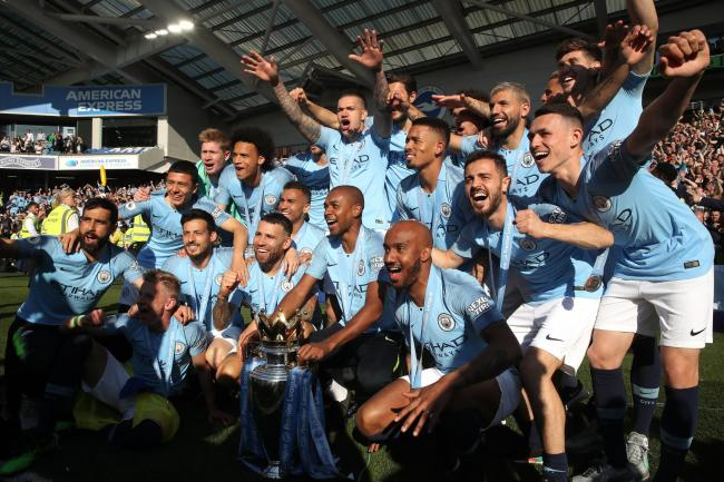 Manchester City celebrate their latest title triumph after winning at Brighton on the last day of the 2018-19 season